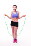 Young fitness woman with healthy sporty figure with skipping rope Stock Photo
