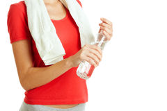 Young fitness woman holding bottle of water Royalty Free Stock Image