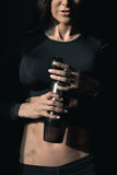 Young fitness woman holding water bottle, healthy living concept Royalty Free Stock Images