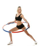 Young fitness woman with hula hoop isolated Stock Photography