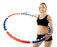 Young fitness woman with hula hoop isolated Royalty Free Stock Photo