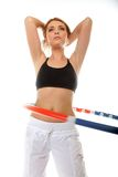 Young fitness woman with hula hoop isolated Stock Image