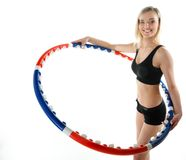 Young fitness woman with hula hoop isolated Stock Photos
