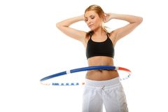 Young fitness woman with hula hoop isolated Royalty Free Stock Photography