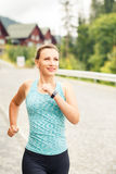 Young fitness woman jogging on cobbled road. Young happy fitness woman jogging on cobbled street of hillside town Royalty Free Stock Photo