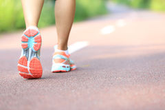 Young fitness woman legs running Royalty Free Stock Photography