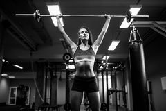 Woman lifting a weight crossfit in the gym. Fitness woman deadlift barbell. Young fitness woman lifting a weight crossfit in the gym. Fitness woman deadlift Stock Photography