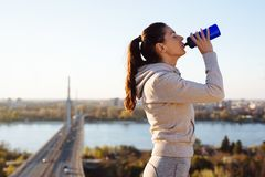Young fitness woman making break from exercising Stock Photography