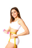 Young fitness woman with measuring tape and dumbbells Stock Photos