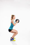 Young fitness woman with medicine ball. Studio shot. Royalty Free Stock Image