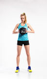 Young fitness woman with medicine ball. Studio shot. Stock Image