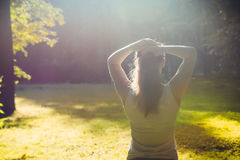 Young fitness woman in morning forest. Young fitness woman get exercises in morning forest Stock Photo