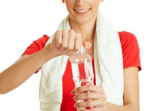 Young fitness woman opening bottle of water Royalty Free Stock Photography
