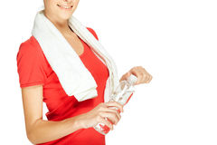 Young fitness woman opening bottle of water Royalty Free Stock Images