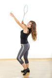 Young fitness woman playing badminton in sweat suit Royalty Free Stock Photos