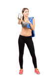 Young fitness woman pointing on the blank mobile phone screen Stock Photo