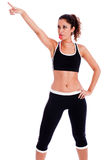 Young fitness woman pointing up the right corner Stock Photography
