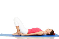 Young fitness woman practicing yoga Stock Images