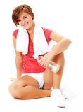 Young Fitness Woman in Red Shirt Isolated on White. Young woman resting after excercise, from a complete series of photos Stock Images