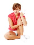 Young Fitness Woman in Red Shirt Isolated on White. Young woman resting after excercise, from a complete series of photos Royalty Free Stock Images