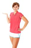 Young Fitness Woman in Red Shirt Presenting, Isola Stock Image