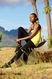 Young fitness woman relaxing after workout Stock Images