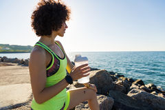 Young fitness woman resting after jogging Stock Photography