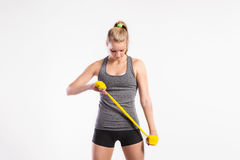 Young fitness woman with rubber bands. Studio shot. Royalty Free Stock Images