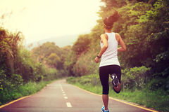 Young fitness woman runner running Stock Photos