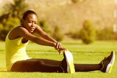 Young fitness woman runner stretching legs in the park Royalty Free Stock Photos
