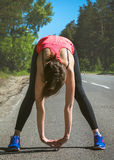 Young fitness woman runner stretching before run. Runner athlete Royalty Free Stock Images