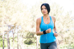 Young fitness woman runnig outdoors Stock Photos
