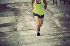 woman running up on city stairs Stock Photo