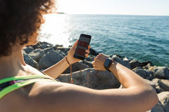 Young fitness woman setting up her smartwatch Stock Image