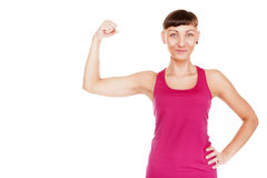 Young fitness woman showing musculs arms. Isolated over white ba Royalty Free Stock Images