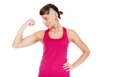 Young fitness woman showing musculs arms. Isolated over white ba Royalty Free Stock Photo