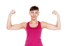 Young fitness woman showing musculs arms. Isolated over white ba Royalty Free Stock Photos