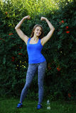 Young fitness woman shows her slenderness. Healthy lifestyle Royalty Free Stock Photography