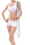 Young fitness woman with skipping rope stock photography