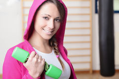 Young Fitness Woman Smiling and Lifting Weights Stock Image
