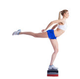 Young fitness woman on stepper Royalty Free Stock Photos