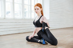 Free Young Fitness Woman Stretching At The Gym Royalty Free Stock Photography - 72976627