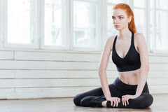 Young fitness woman stretching at the gym Royalty Free Stock Photography