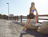 Young fitness woman stretching her muscles Stock Photo