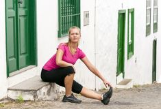 Young fitness woman stretching muscles Royalty Free Stock Photography