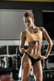Young fitness woman tired in gym and listen music with headset Royalty Free Stock Photography