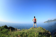 Young fitness woman trail runner enjoy the view Stock Photos