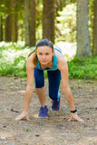 Young fitness woman trail runner with smartwatches ready to run Stock Photo