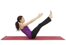 Young fitness woman training her ab muscles royalty free stock image