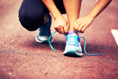 Young fitness woman tying shoelaces Royalty Free Stock Photo